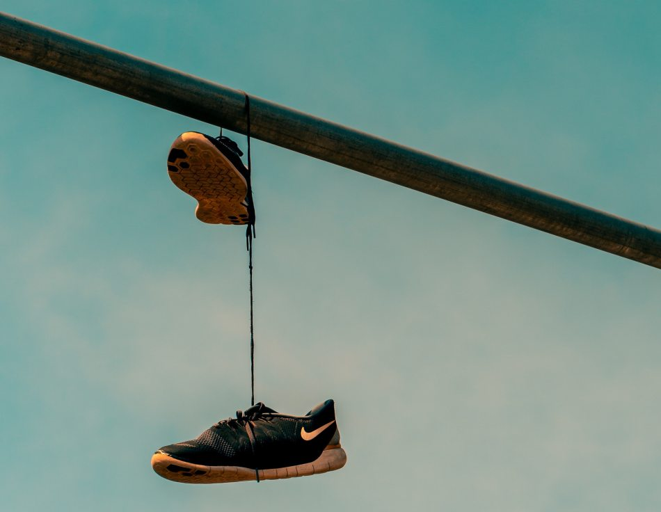 running sneakers hanging on wire